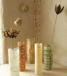 Make Vases with glasses, you can also use this idea for candle holders with whiskey glasses.