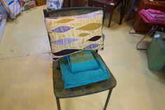 Barkcloth pillow, vintage towels & a super cool folding chair.