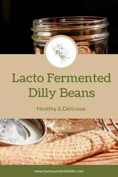 There may be no better quick, easy and healthy way to preserve fresh green beans than by lacto fermenting them! These dilly beans are crunchy, spicy, and scrumptious straight from the jar! | It's My Sustainable Life @itsmysustainablelife #lactofermenteddillybeans #fermenteddillybeans #fermenteddillybeanrecipe #itsmysustainablelife