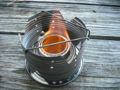 Several cool examples of DIY camp stoves and DIY windscreens. Also simmering devices.