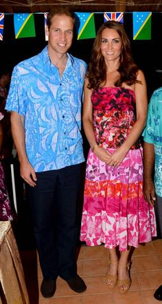 September 16, 2012: Prince William and Kate Middleton attend an Island Feast, and both are wearing local Solomon Island designer TAV Pacific. Kate has accessorized with her Stuart Weitzman Minx wedges, a gold bracelet by Catherine Zoraida and red coral earrings by Serretta.