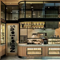 A welcoming, wood-covered storefront in Sydney's Galeries Victoria invites snacky shoppers to try healthy handmade treats at Nutorious.