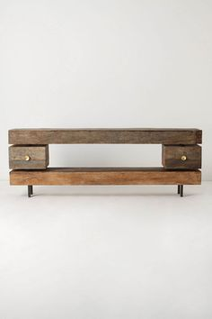 great modern/minimal media console from #anthropologie. love the contrast of modern lines with rustic, reclaimed wood...