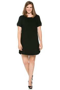 Black Curve Hem Shift Dress (Sizes S - 2XL) – ROUTE 32  Black shift dress with curved bottom hem and sleeves.  Chic back zipper detail.  Versatile style! Dress up with statement jewelry and heels. Add a belt to accentuate your figure. Dress down with sandals or flats. Perfect transitional piece for fall: Layer with a cute jacket or blazer, add color with a scarf or colorful tights, and finish with your favorite boot.