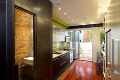 contemporary  by KUBE architecture (tile underneath cabinets so wood floors do not get wet)