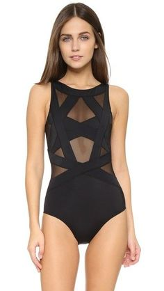 9a0817121fb4f Black OYE Swimwear swimsuit for woman This OYE Swimwear swimsuit is  detailed with geometric straps backed by sheer mesh. Available sizes:  L,M,S,XS Más