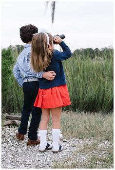 Siblings hugging in front of the marsh. Fall family photos at The Landings in Savannah Georgia. Downtown Savannah Georgia family photos photographed by Kristen M. Brown of Samba to the Sea Photography. #familyphotos #savannah #savannahga