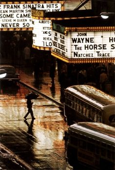 pedestrian in rain on 42nd street, nyc, usa, 1964