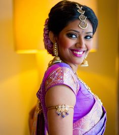 South Indian bride. Gold Indian bridal jewelry.Temple jewelry. Jhumkis.Purple silk kanchipuram sari.Braid with fresh flowers. Tamil bride. Telugu bride. Kannada bride. Hindu bride. Malayalee bride.Kerala bride.South Indian wedding.