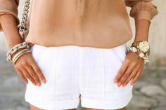 clean white shorts + neutral toned blouse + arm candy
