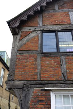 """Brick infill or 'nogging' - medieval timber frame house construction. """"Half-timbering"""" is a house with filler between wide-spaced beams. Wood beams were expensive! Even though the wealthy find such facades enchanting today, hundreds of years ago, they were the sign that a person was poor."""