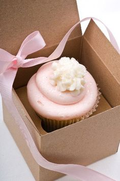The only reason I'm posting a pink wedding cupcake is because it has edible glitter on it.