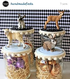 Realistic baby rubber animals on jar lid, Pom Pom trim, wood shaving type 'grass' and foil mini chocolate eggs. Very cute.