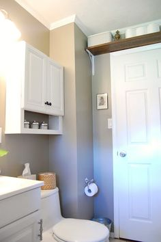 Oh happy day! Our main bathroom used to be small and storage-challenged.The only storage the room used to have was the cabinet under the s...