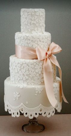 Chic four tier floral detailed wedding cake with blush bow; Featured Cake: Cotton & Crumbs