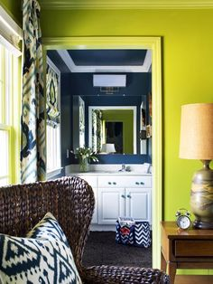 Simple and stylish DIY tricks turn a spatially challenged en suite bathroom into a bold-colored showstopper.