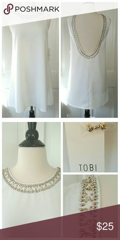 White Tobi Dress White dress by Tobi, with bead and rhinestone/crystal trim at neck, shoulder, and back. Deep back. Extra beads and rhinestones/crystals. Tobi Dresses Mini