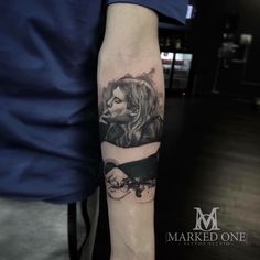 Kurt Cobain portrait by Adam. Small forearm portrait. Black and grey tattoo.