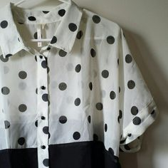 Sheer Button-down Sheer, collared button-down, black on the bottom, white with black polka dots on top. The shirt is shorter in the front. For reference I'm 5'3 and size L. Nwt.  4 for $15 sale! Last Kiss Tops Button Down Shirts