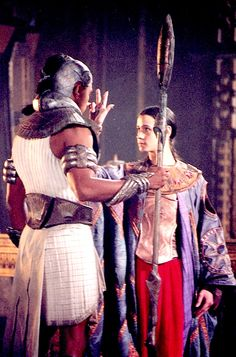 Stargate. Jaye Davidson as Ra with Anubis played by Carlos Lauchu.  You can see the unusual pleating in his white tunic we created.  #josephporro designs