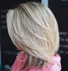 Mid-Length Feathered Blonde Hairstyle