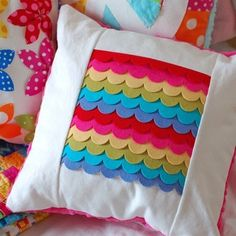 Felt rainbow cushion – Seen on Pintrest, loved and pinned by Craft-seller.com. The only magazine for those who love to make and sell.