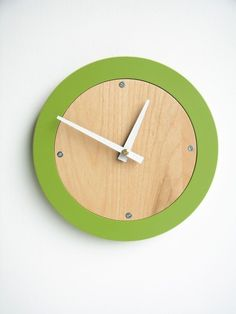 Passing the minutes stylishly in my office with this apple green modern wall clock.