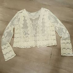 Beautiful top NWOT.  Such a gorgeous top.   I have never worn it. Billabong Jackets & Coats