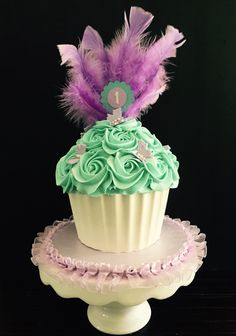 Purple and teal smash cake with feather topper