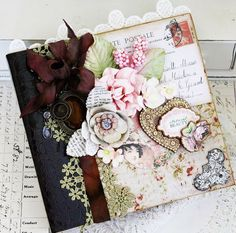 """""""There are so many beautiful new Prima products to look forward to!  I've used a few of my favorites on my Memory Hardware Square Journal today.   I couldn't wait to put the new Memory Hardware Artisan Leather Paper to use and added it down the spine of my binder to create a realistic feel."""""""