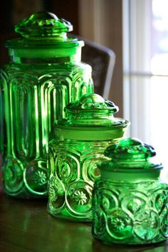 Green Glass Jars. I have one turquoise large one like this-vintage. Found it at an estate sale. I want this green set. If you know where I can find them, please advise. :)