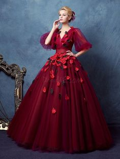 I would love this dress if it didn't have that awfulnflower and all the cheap looking petals sewn all over it.