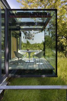 The Jodlowa House  http://freshome.com/2011/04/18/stunning-house-with-fully-glazed-steel-frame-structure-the-jodlowa-house-by-pcko/