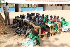 Somali children attend an outdoor classroom at the Friends Primary School  in Ifo Refugee Camp,