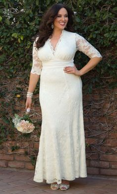 **I like this dress. Check out the deal on Amour Lace Wedding Gown at Kiyonna . Coupon code extra 20.