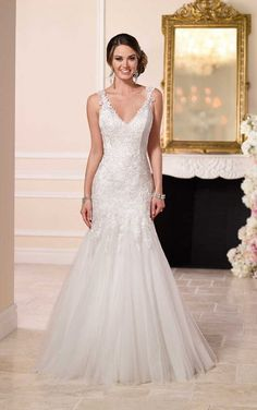 6106 Beaded Lace and Tulle Satin Wedding Dress by Stella York. Fit and flare with v-neck and natural waist. Chapek train. Fabric: lace & Embellishments: beading