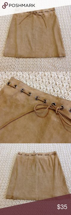 "Gorgeous vintage tan suede mini skirt So sexy! Beautiful real suede mini skirt, fully lined. Lovely shade of tan/camel brown. Drawstring and grommets at waist. Raw hem. Zips at back. Looks great with a boho top and sandals or boots! Excellent vintage condition, no flaws! Size 4. Measurements: 15"" waist, 17"" long. Has a very 1970s vibe but I'm not positive how old it is...possibly 90s looking at the tag. Vintage Skirts Mini"