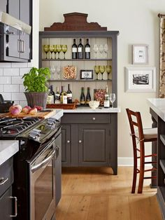 I loved this bar hutch...but in a mini version for your corner spot.  Deep enough to house the fridge.  The colour is also outstanding - would work well in that room, esp with a light grey/blue on the walls.  And antlers above!