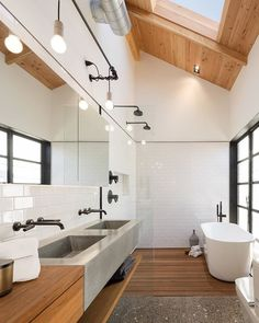 A skylight illuminates the neutral master bathroom, letting bathers contemplate the clouds. The faucets and tub are by @brizofaucet , and the sinks are @slabhaus . #bathroom #interior #modern  Photo by @roehnerrr Architecture by Jonah Busick of Foundry12 Interior Design by Joel Contreras