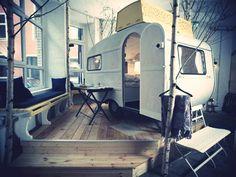 fantastic idea for loft/open plan bedroom: a small camper trailer! (hüttenpalast concept hotel, berlin)