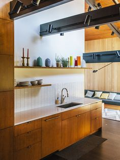 For the kitchen, master bath, and kids' bathroom, in a renovated midcentury house, the designers chose three different hues of Savoy stacked mosaic tile from Portland-based manufacturer Ann Sacks. The countertop is PentalQuartz.  Photo by Grant Harder.   This originally appeared in Midcentury Renovation in Portland Capitalizes on Nature with Seven Doors to the Outside.