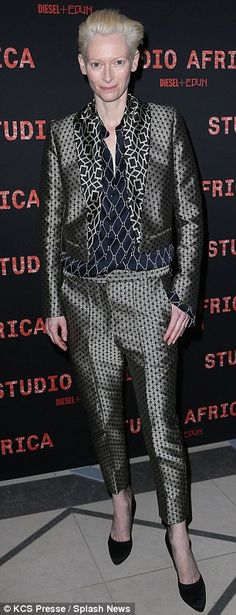 A-list guests: Tilda Swinton opted for a quirky trouser suit as she joined a casual looking Adrien Brody inside