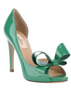 All of my favorite things in one shoe... Green patent leather sandal from Valentino featuring an open toe, large front bow, cut out side and a leather covered stiletto heel.