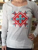 Four Calling Birds Ladies Shirt---Our fourth tee from the 12 Days Of Christmas collection. Red, Turquoise, and white design is printed on silver, ladies' long sleeve.