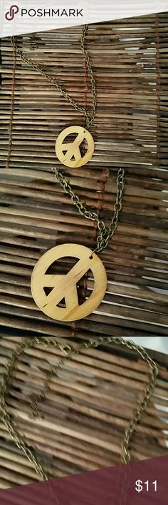 Wooden Peace Sign Necklace Wooden Peace Sign Necklace, in excellent condition! Other Jewelry Necklaces
