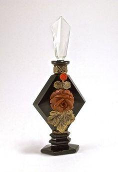 1920s Czechoslovakian perfume bottle, black crystal, clear stopper, gilt metal filigree, Bakelite and crystal jewels
