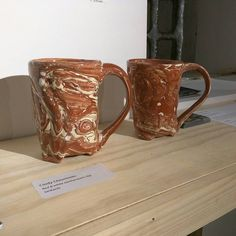 Here are some earthenware tankards I made with swirled red and white clay. They are for sale at the All Fired Up show opening at Piano Craft Gallery. The show will be up through the end of the month. #ccceramics #ccceramicsforsale #forsale #gift #artsale #productphotography #potteryphotos #photographingpottery #bostonpotter #tankard #stien #mug #cup #drink #drinkme #terracotta #earthenware #handmade #handmadepottery #handcrafted