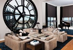 Coolest 'wall clock' ever -- window onto the Brooklyn Bridge.  Penthouse at One Main Street, in Dumbo, Brooklyn.  (Lame couches, though)
