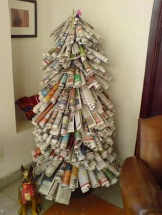 No money for a Christmas tree this year? The rolled newspaper Christmas Tree. Don't forget to decorate it!