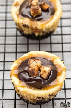 Mini Snickers Cheesecakes topped with Chocolate Ganache & Caramel Topping are cute little mini treats perfect for Valentine's Day!